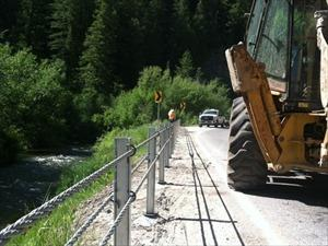 Cable barrier installed on dangerous Logan Canyon curve.