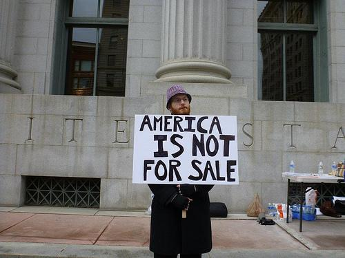"""America is not for sale"" poster at Salt Lake City Move to Amend rally."