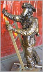 A bronze statue of a fireman cast at Adonis Bronze by Ron Pekar. There was a deadly explosion at the foundry.