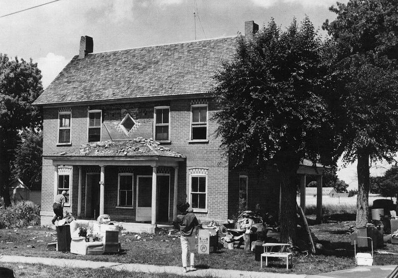 Many of the town's residences were damaged in the earthquake of 1962. This house lost several bricks, and must have received some interior damage, judging from the fact that many things have been moved out to the lawn.