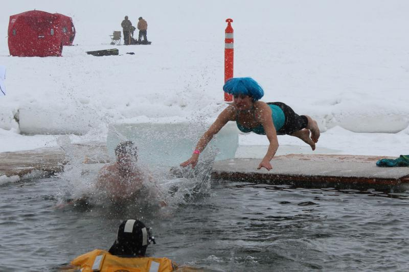This woman told her husband (the splash on the left) that she was going to bellyflop. She did.