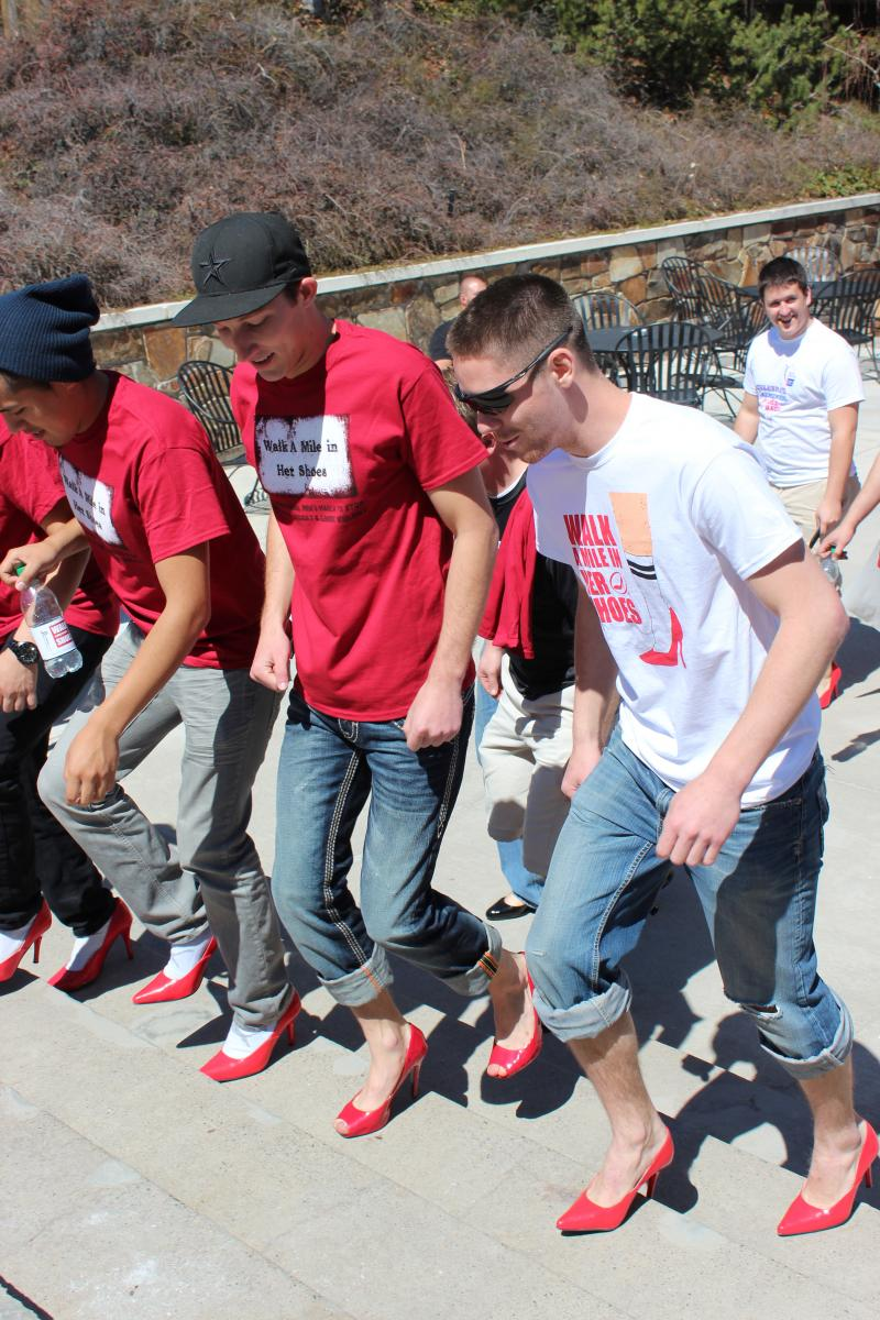 Members of the Delta Sigma Phi Fraternity at USU walk a mile.
