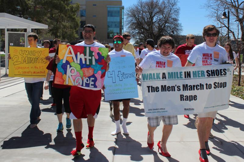 The front of the group carried signs calling for the end of sexual assault and rape on college campuses, as well as facts about these issues.