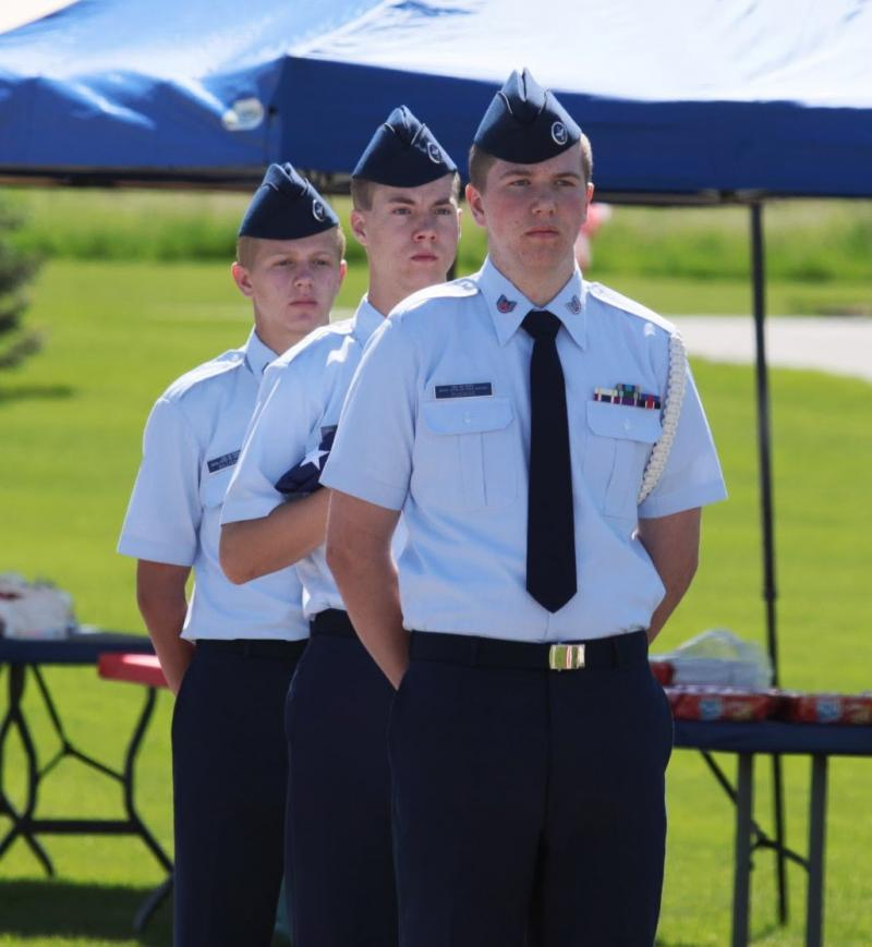Cadets of the Civil Air Patrol, Cache Wing, stand at attention Monday at the North Logan Cemetery.