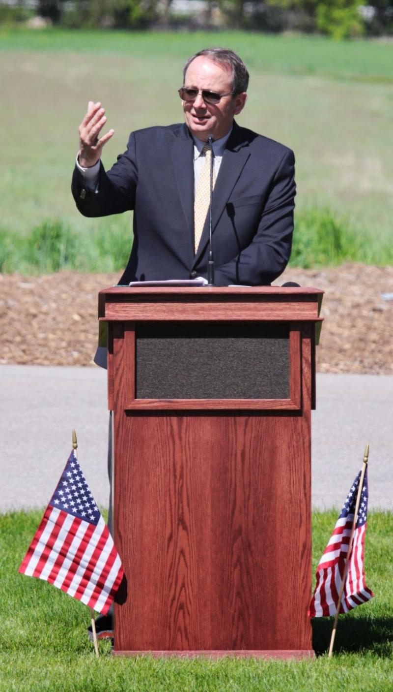 Retired Maj. Gen. Brian L. Tarbet speaks Monday at the North Logan Cemetery.