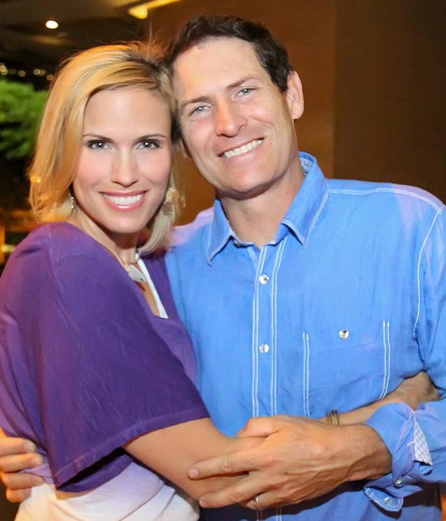 Barb and Steve Young hugging.