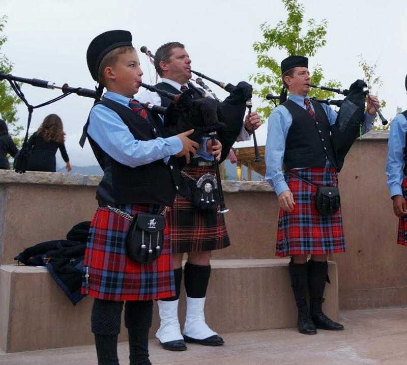 Members of the WDPB Bagpipe Band perform.