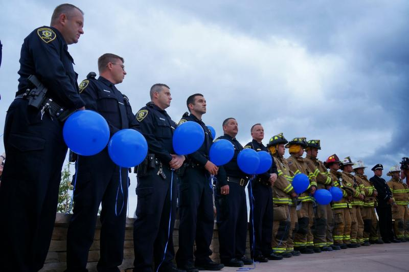Police officers stand at attention during a 9/11 memorial service in Kaysville.