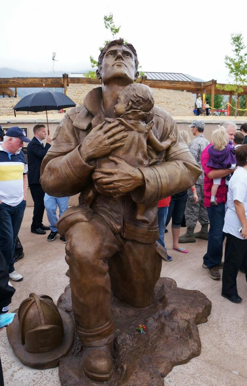 Police, fire and military officials helped unveil this statue of a firefighter at the new 9/11 memorial in Kaysville.