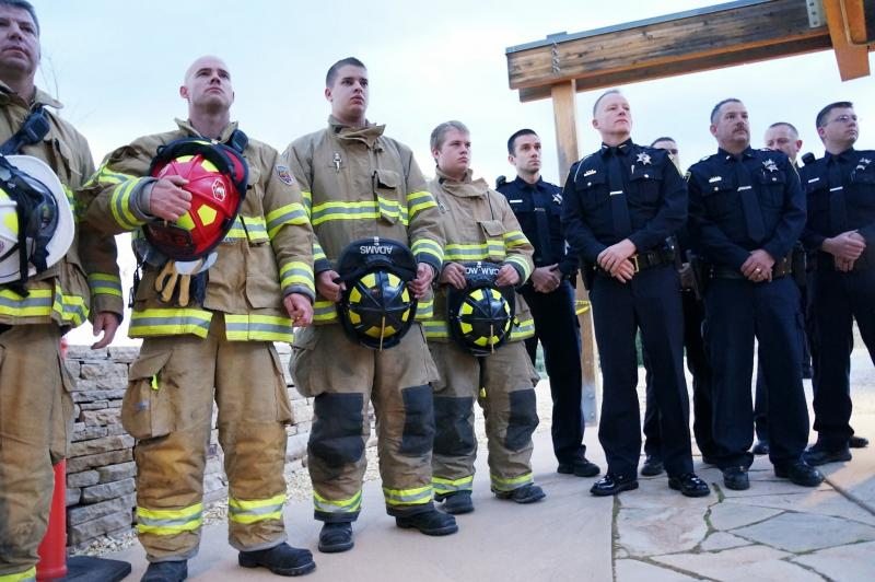 Firefighters and police officers participate in the unveiling of a new 9/11 memorial in Kaysville.