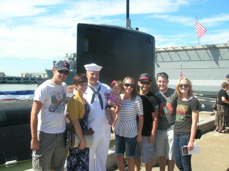 Petty Officer Third Class Dane Jorgenson with his family on the day of the commissioning.