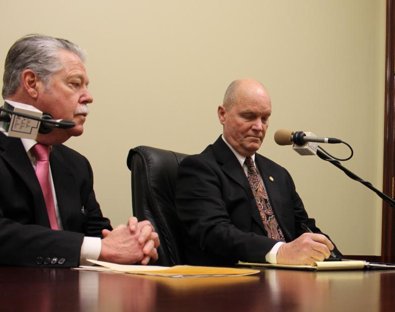 senator Okerlund and Davis at a table