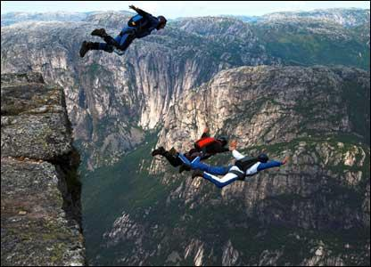 base jumpers leap off cliff