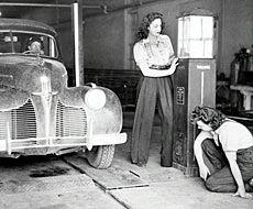 Women working on a car ca. 1940s
