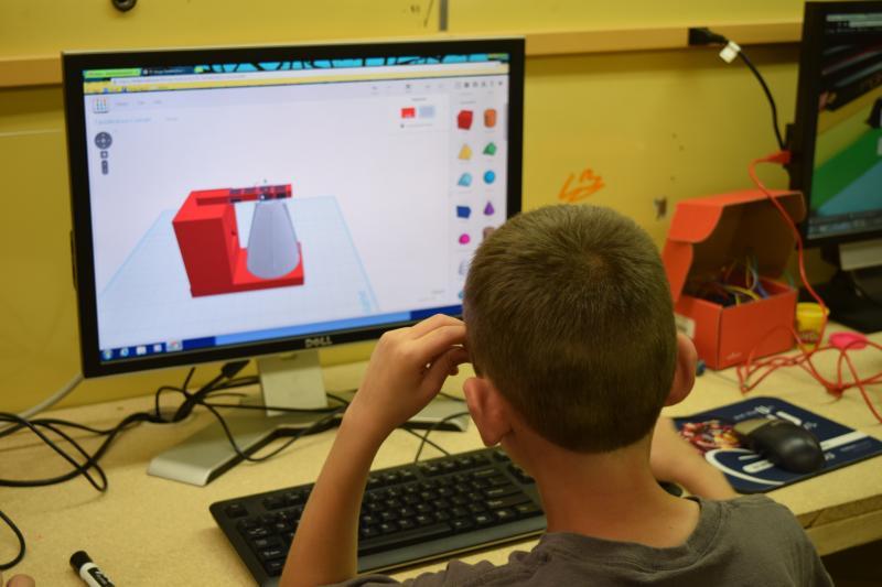Student preparing design for the 3D printer.