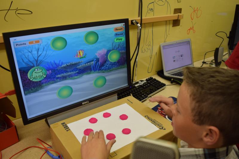 Student playing his newly-designed responsive videogame.