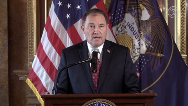 Governor Herbert in front of Utah, US flags