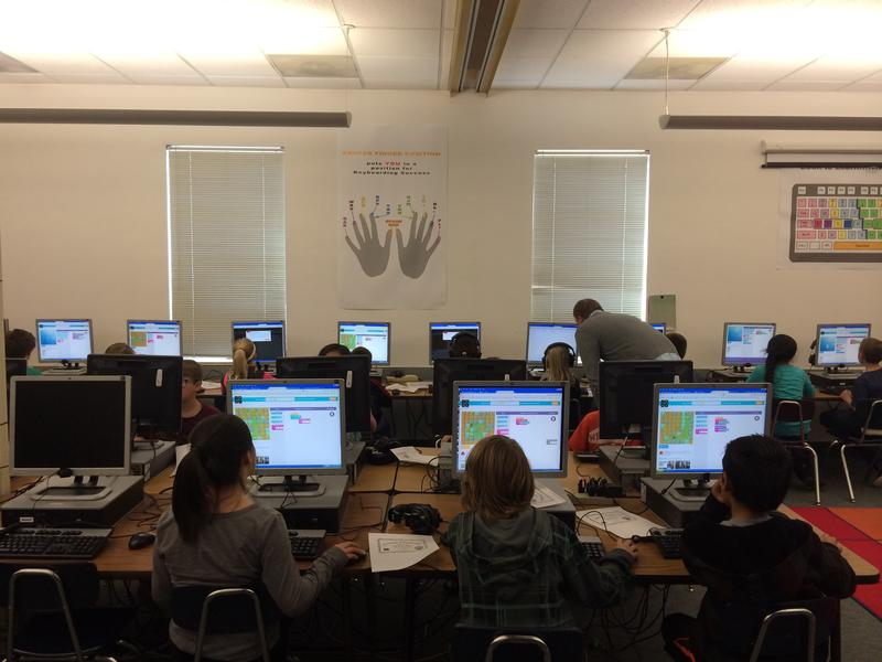 Kids coding in their classroom.
