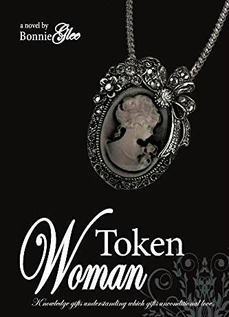 "The cover of the book: a picture of a cameo necklace on a black background with the title ""Token Woman."" Subtitle ""knowledge gifts understanding which gifts unconditional love."""