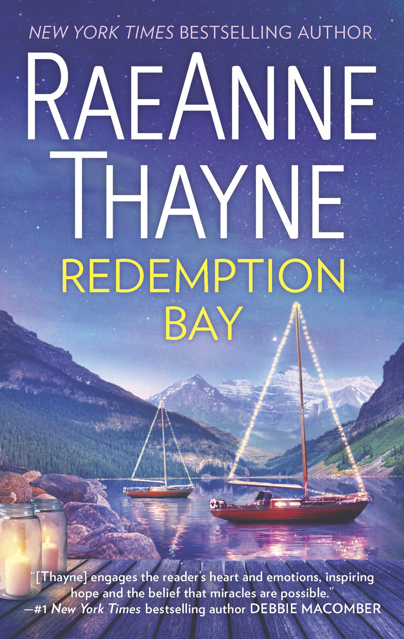A photo of the book Redemption Bay. Several sailboats sit on a small lake surrounded by mountains.