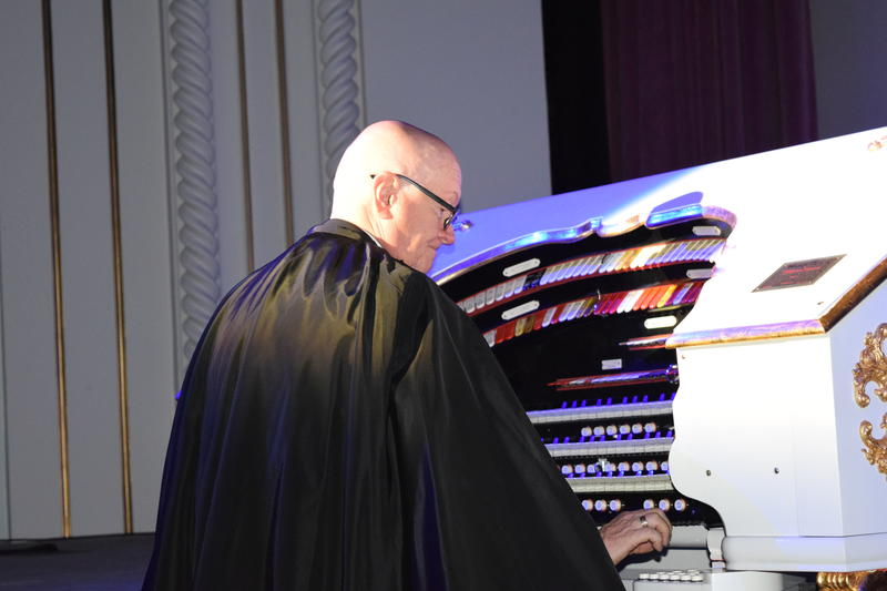 UFOMT Founding General Director Michael Ballam plays on an organ in the Utah Theatre.