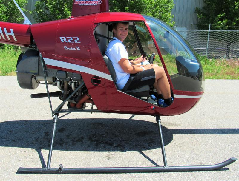 A helicopter instructor shows a student how to prepare for lift off.
