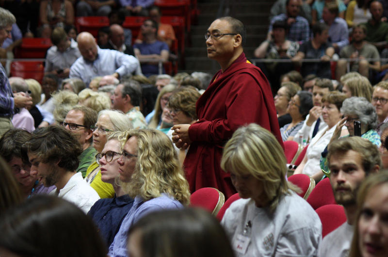 A Tibetan monk waits in a crowd of people at His Holiness the Dalai Lama's event at the University of Utah in Salt Lake City, Utah, June 22, 2016.