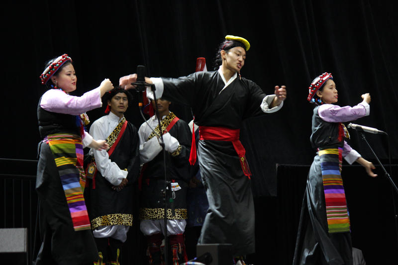Traditional Tibetan performs dance at His Holiness the Dalai Lama's event at the University of Utah in Salt Lake City, Utah, June 22, 2016.