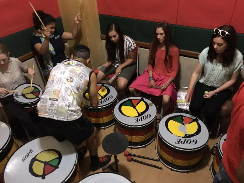 Utah State University students at their drumming lesson with Gilmario.