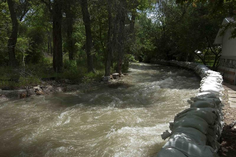 Spring Runnoff in Cottonwood Creek near Sandbagged Home