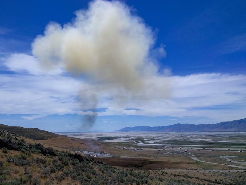 A cloud of smoke rises after the test firing of the launch abort motor at Promontory Point, Utah on June 16, 2017.