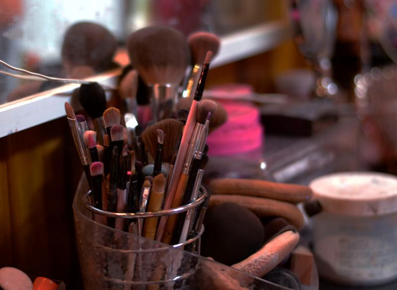 Makeup brushes and lipsticks sit on the vanity table in Kay Bye's Salt Lake apartment.