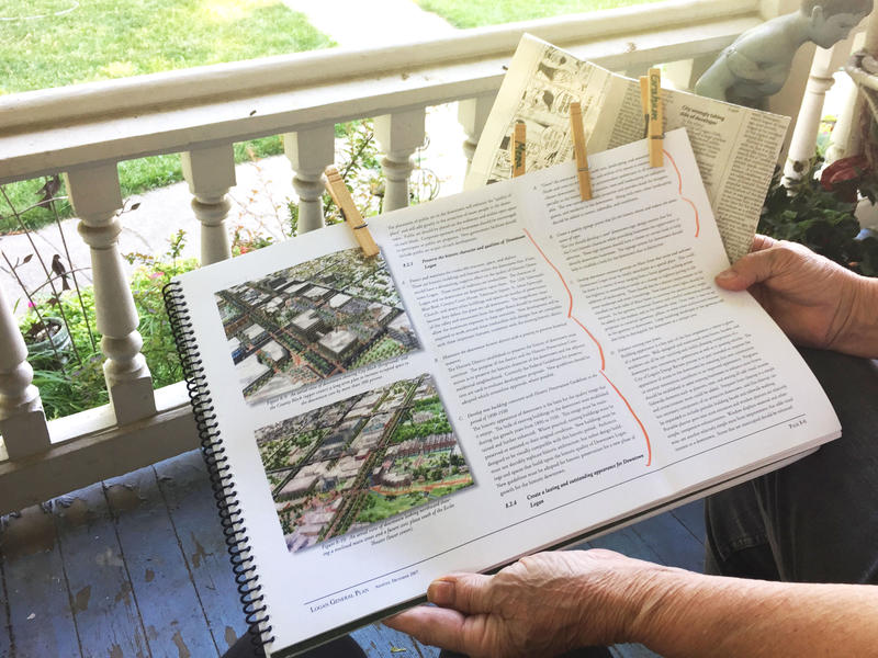 Sitting on her front porch with a copy the City of Logan's general plan in her lap, Susan Bird shows a portion of the text she's marked as part of the Garden Park Apartments debate (Logan, Utah, July 31, 2017).