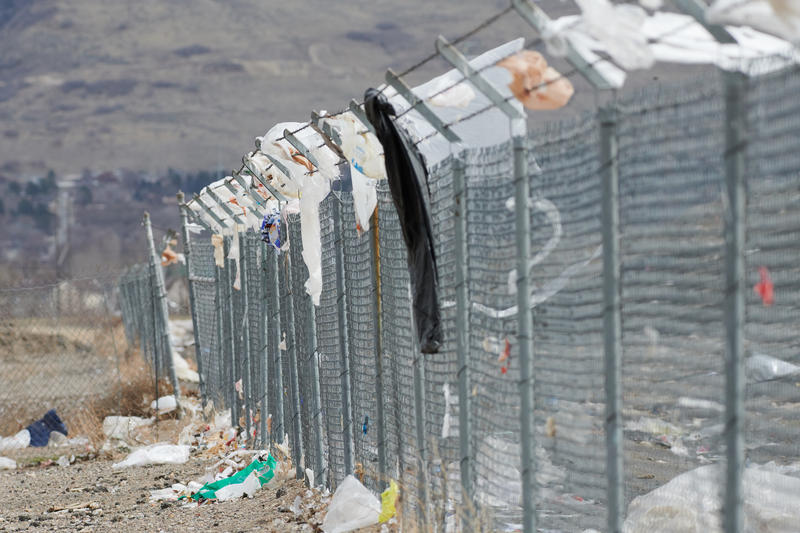 Plastic bags and other garbage along the fence at Farmington Bay.