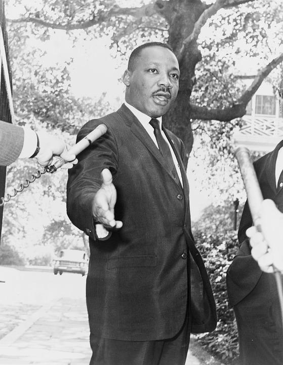Dr. Martin Luther King Jr. being interviewed by the press.