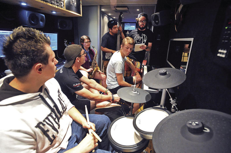 Pocatello High School Students rehearse their song on the Bus