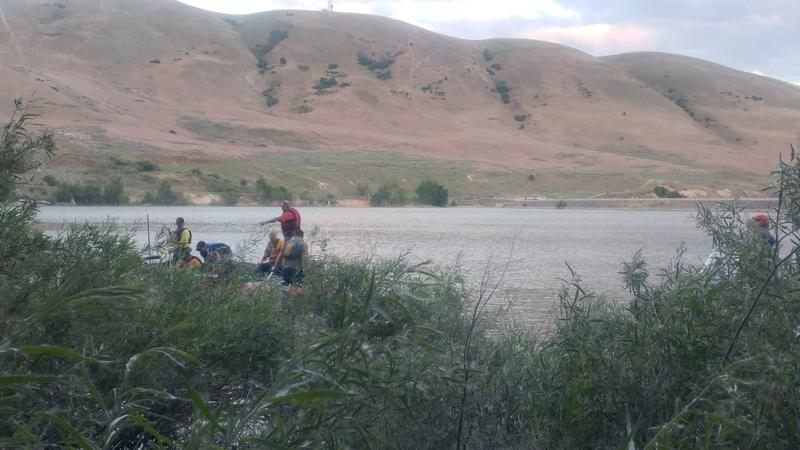 Volunteers search for missing man in Newton Dam.