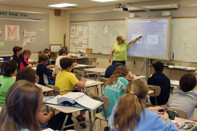 Middle School Teacher Teaching a class;A new curriculum will focus on the history of women's rights in Utah.