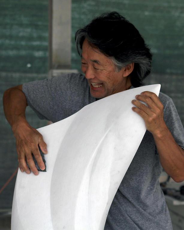 Suzuki working on one of his pieces