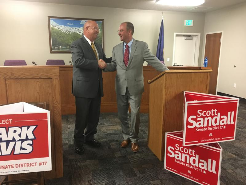 Clark Davis and Scott Sandall, Republican Candidates for Utah State Senate District 17, shake hands after Tuesday's debate.