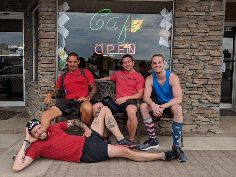 Griffith and his running crew sitting infront of Cowan's Cafe in Duchesne, Utah
