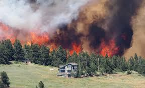 Wildfires blaze in more than half a dozen places around Colorado.