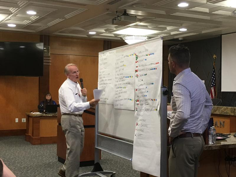 Logan City Visioning Meeting; Developers from Cowboy Partners stand in front of a list of ideas for future developments on Logan's central block.