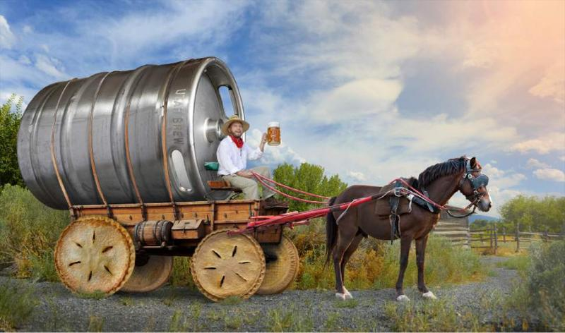 A keg wagon with pie wheels and a beer drinking wagon driver. Background the sun setting sun over the prairie.