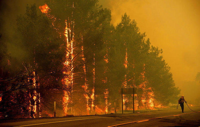Wildfire causes evacuation of 300 houses.