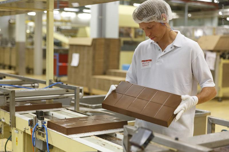 Man making chocolate; The new Aggie Chocolate factory will let visitors see the bean to bar process of chocolate making.