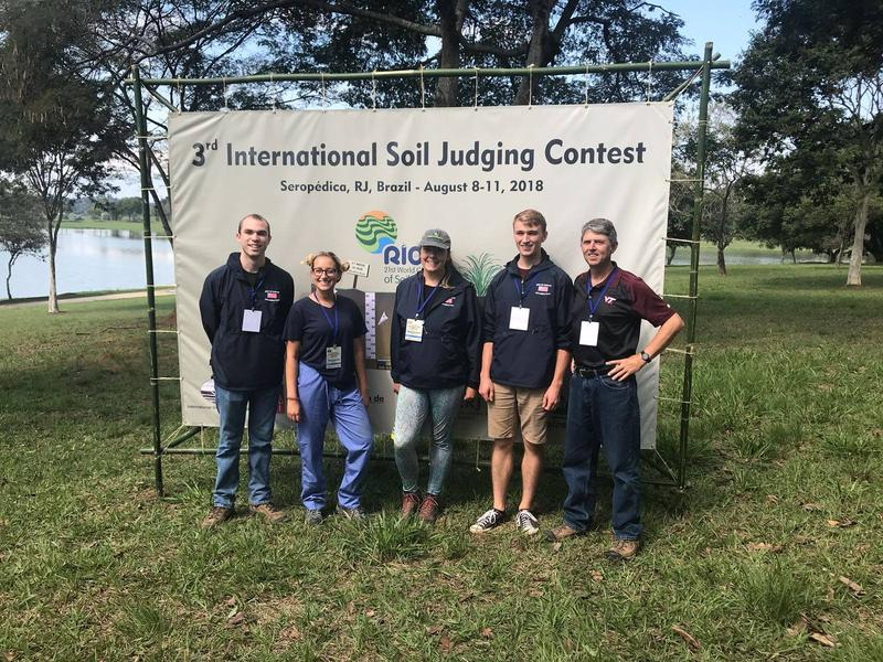 Emma, middle, with her soil judging team from the U.S. in Brazil.