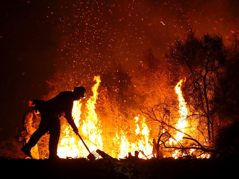 Firefighter battles California wildfire.