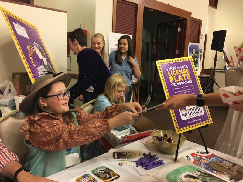 Girls selling art; Dalloway Smith and Gwyneth Park sell artwork at the Better Days 2020 event.