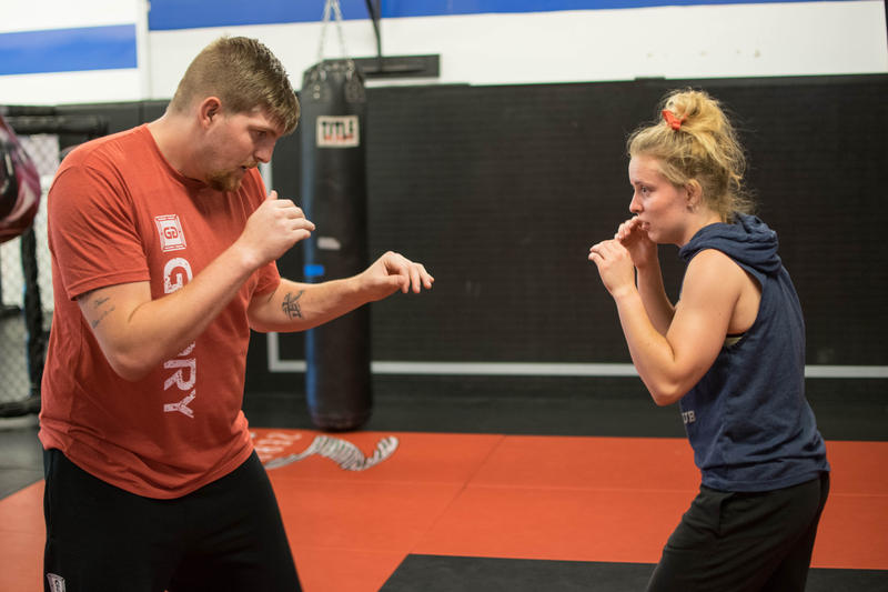 Kaycee Pearce training with coach Stephen Page in Preston, Idaho, after winning Mountain Force MMA title